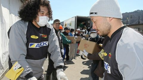 Kamaishi Seawaves' players assist with recovery efforts after the earthquake and tsunami.