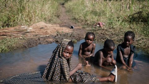Children play in a stream created by flooded water after the passage of the cyclone Idai, in Mozambique, on March 24, 2019. Scientists say more frequent flooding increases the risk of diseases.