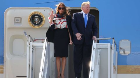 US President Donald Trump (R) and US First Lady Melania Trump (L) disembark Air Force One at Stansted Airport, north of London on June 3, 2019, as they begin a three-day State Visit to the UK. - Britain rolled out the red carpet for US President Donald Trump on June 3 as he arrived in Britain for a state visit already overshadowed by his outspoken remarks on Brexit. (Photo by Isabel Infantes / AFP)        (Photo credit should read ISABEL INFANTES/AFP/Getty Images)