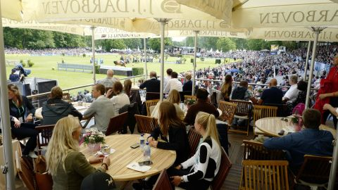 Spectators enjoyed lavish hospitality in the German city as the world's best show jumpers competed just yards from their seats.