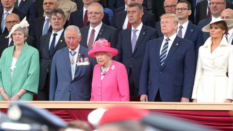 Britain's Queen Elizabeth II and Prince Charles play host to the Trumps at the D-Day event in Portsmouth. British Prime Minister Theresa May is at left.