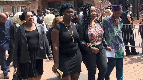 Garner's mother, Gwen Carr, second from right, leaves court flanked by family members Wednesday.
