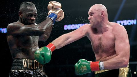 Tyson Fury punches Deontay Wilde in the seventh round fighting to a draw during the WBC Heavyweight Championship in December 2018.