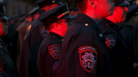Police are lit by flashing lights as they stand in formation while the casket of slain New York City Police (NYPD) officer Randolph Holder is carried from the Greater Allen A.M.E. Cathedral of New York following his funeral service in the Queens borough of New York City, October 28, 2015. Holder's funeral comes more than a week after he was shot to death while on patrol in New York City's East Harlem neighborhood. He is the fourth New York City officer to be killed on duty in the last 12 months. REUTERS/Shannon Stapleton