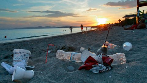 ATHENS, GREECE - JUNE 26: Plastic cups used by tourists on the Aegean sea beach near Athens on June 26, 2018 , Greece . The Mediterranean is one of the seas with the highest levels of plastic pollution in the world .More than 200 million tourists visit the Mediterranean each year causing the 40% increase in marine litter during summer  using  single use plastics including straws and stirrers, plastic cups, water bottles , inflatable pool toys etc which   leads to the general pollution of water and beaches along Mediterranean. (Photo by Milos Bicanski/Getty Images)