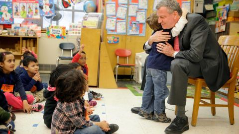 NEW YORK, NY - FEBRUARY 25:  New York City Mayor Bill de Blasio hugs a child after reading a book to a pre-kindergarten class at P.S. 130 on February 25, 2014 in New York City. De Blasio stopped by the classroom after a news conference about his plans for universal pre-kindergarten in New York City. (Photo by Seth Wenig-Pool/Getty Images)