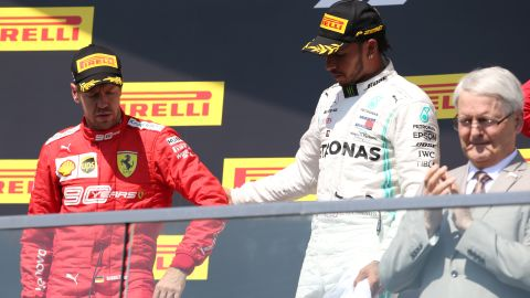 Sebastian Vettel reluctantly made his way to the podium after the stewards' decision.