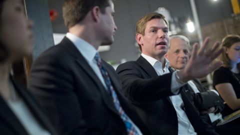 Swalwell and other members of Congress talk with young entrepreneurs at an event in New York in April 2015.