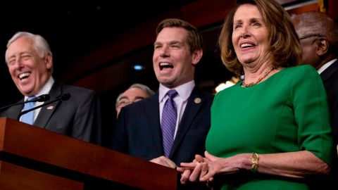 House Minority Leader Nancy Pelosi and Democratic Whip Steny Hoyer react at a Swalwell joke during a Capitol Hill news conference in March 2017.