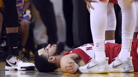 Toronto guard Fred VanVleet lies on the floor after he was hit in the face by an inadvertent elbow in Game 4. One of his teeth was also knocked out.
