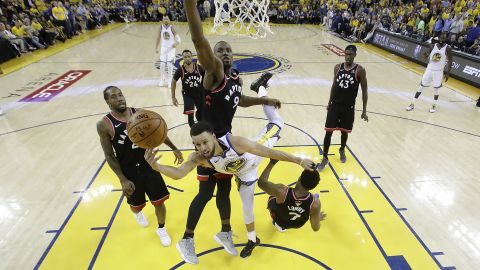 Curry is surrounded by Raptors during Game 3 on Wednesday, June 5. He scored 47 points, a playoff career-high, but it wasn't enough as the Raptors won 123-109.