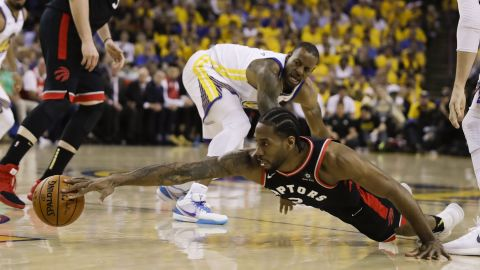 Leonard reaches for a loose ball during the first half of Game 3. He finished the game with 30 points, seven rebounds and six assists.