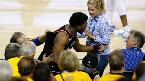 """Lowry argues with Mark Stevens, a Warriors investor who pushed him in Game 3 after Lowry jumped into the seats for a loose ball. Stevens was fined $500,000 for <a href=""""https://www.cnn.com/2019/06/06/sport/kyle-lowry-pushed-by-warriors-investor-mark-stevens-spt-intl/index.html"""" target=""""_blank"""">the altercation</a> and banned from Oracle Arena for a year."""