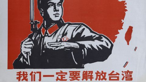 """An historic Chinese Cultural Revolution poster, showing a Chinese soldier and the island of Taiwan. """"We must liberate Taiwan,"""" the caption says."""