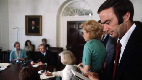Sam Donaldson takes notes at a briefing by President Jimmy Carter.