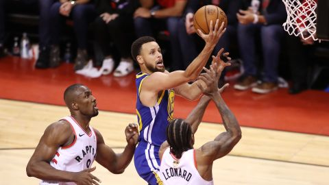 Curry rises for a shot during Game 5 on Monday, June 10. Curry had 31 points for the Warriors, who staved off elimination with a 106-105 win in Toronto.