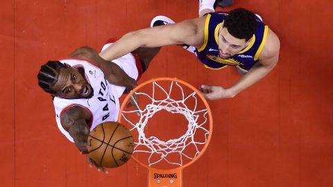 Leonard scores over Thompson during the second half of Game 5.