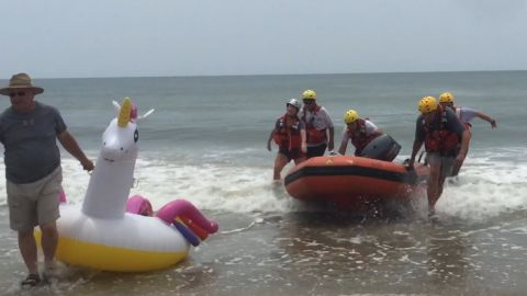 Oak Island Water Rescue saved an 8-year-old boy who drifted out into the Atlantic Ocean on a unicorn float.