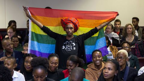 Activist Kat Kai Kol-Kes holds a LGBTQ pride flag inside Botswana's High Court on Tuesday, where lawmakers  overturned a law that criminalized same-sex relations.