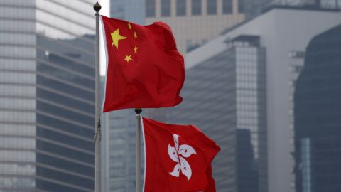 Chinese, left, and Hong Kong flags are displayed outside the Central Government Offices in Hong Kong, China, Saturday, Oct. 4, 2014. A week into demonstrations in Hong Kong notable for their order and endurance, protesters came under attack from opponents, highlighting the fault lines of a city torn between commercial interests and a desire for greater democracy. Photographer: Tomohiro Ohsumi/Bloomberg via Getty Images