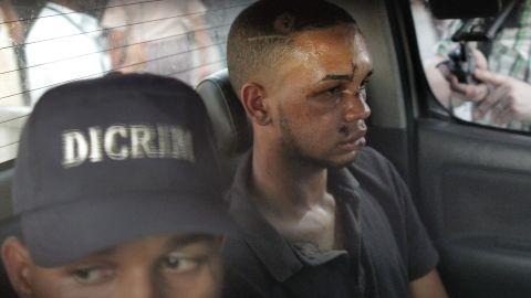 Eddy Vladimir Féliz Garcia gets transported by police to court Tuesday.