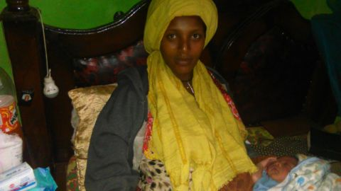 Almaz Derese, 21, and her son on Wednesday, June, 12, 2019.
