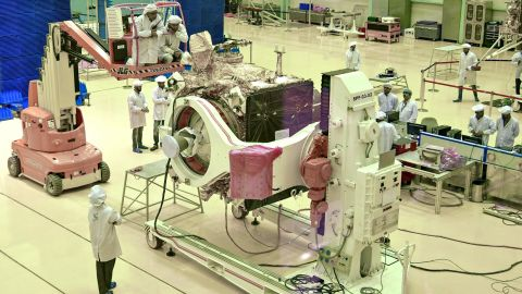 """Scientists work on the orbiter vehicle of """"Chandrayaan-2"""" for India's first moon lander and rover mission."""