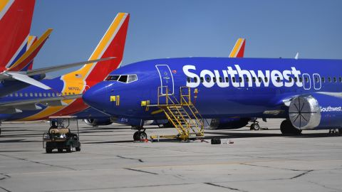 Southwest Airlines Boeing 737 MAX aircraft are parked on the tarmac after being grounded, at the Southern California Logistics Airport in Victorville, California on March 28, 2019. - After two fatal crashes in five months, Boeing is trying hard -- very hard -- to present itself as unfazed by the crisis that surrounds the company. The company's sprawling factory in Renton, Washington is a hive of activity on this sunny Wednesday, March 28, 2019, during a tightly-managed media tour as Boeing tries to communicate confidence that it has nothing to hide. Boeing gathered hundreds of pilots and reporters to unveil the changes to the MCAS stall prevention system, which has been implicated in the crashes in Ethiopia and Indonesia, as part of a charm offensive to restore the company's reputation.(Photo credit should read MARK RALSTON/AFP/Getty Images)