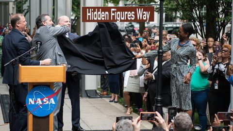 The Hidden Figures Way street sign is unveiled at a dedication ceremony Wednesday at NASA headquarters in Washington.