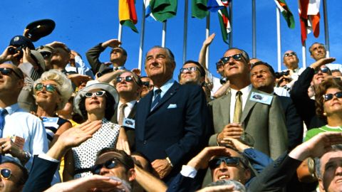 Former US President Lyndon B. Johnson and then-Vice President Spiro Agnew were among those watching the launch at Florida's Kennedy Space Center.