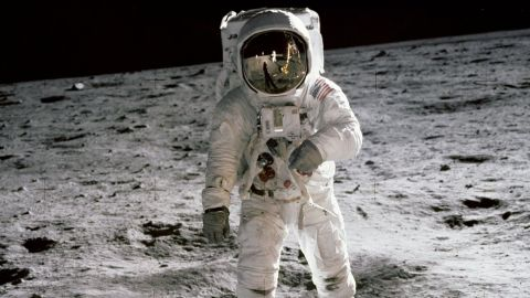 """Aldrin walks on the surface of the moon. He and Armstrong spent a little over two hours collecting rock samples and data near the moon's Sea of Tranquility region. They also left behind a plaque signed by all three crew members and President Richard Nixon. The plaque reads: """"Here men from the planet Earth first set foot upon the moon, July 1969 A.D. We came in peace for all mankind."""""""
