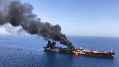 An oil tanker on fire near the strategic Strait of Hormuz on Thursday, June 13, 2019.