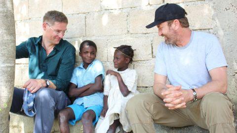CNN Hero Magnus MacFarlane-Barrow and Gerard Butler in Haiti