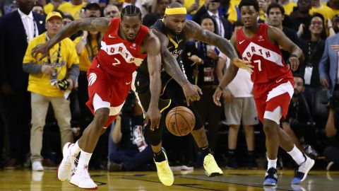 Leonard and DeMarcus Cousins battle for a loose ball late in Game 6 as the Raptors led by one and the last few seconds ticked away.