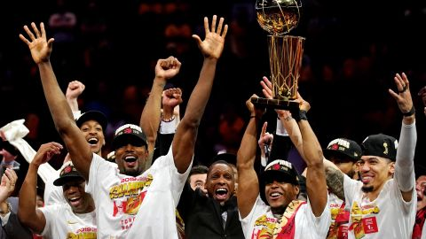 The Raptors celebrate with the Larry O'Brien Trophy.