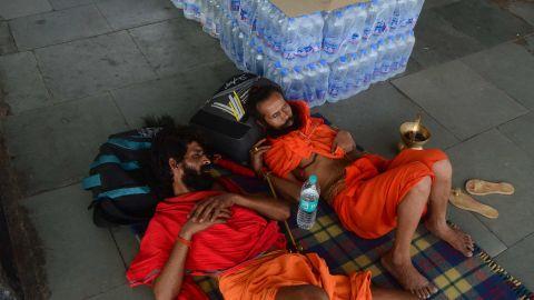 Passengers rest near water bottles at Allahabad railway station in Uttar Pradesh, India on June 11, 2019.