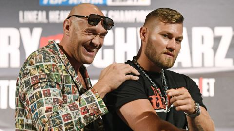 Boxers Tyson Fury (left) and Tom Schwarz pose ahead of their heavyweight bout.