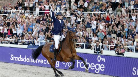 Peder Fredricson celebrates after winning the inaugural LGCT in the Olympic Stadium in Stockholm.