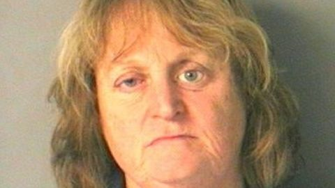 Nancy Bucciarelli is charged with cruelty to animals after pushing her dog into a lake and watching it drown.