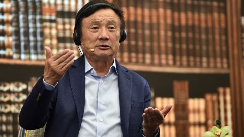 Huawei founder and CEO Ren Zhengfei gestures as he hosts a panel discussion on technology, markets and enterprise in Shenzhen on June 17, 2019.