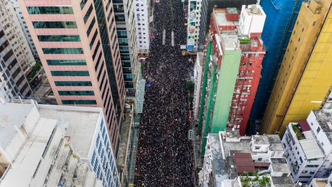 TOPSHOT - This overhead view shows thousands of protesters marching through the street as they take part in a new rally against a controversial extradition law proposal in Hong Kong on June 16, 2019. - Tens of thousands of people rallied in central Hong Kong on June 16 as public anger seethed following unprecedented clashes between protesters and police over an extradition law, despite a climbdown by the city's embattled leader. (Photo by STR / AFP)        (Photo credit should read STR/AFP/Getty Images)