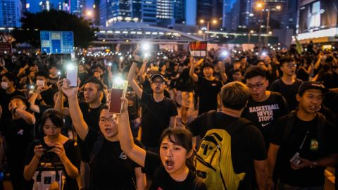 Protesters shine lights from their mobile phones during rally against a controversial extradition law proposal on June 16, 2019 in Hong Kong, China.