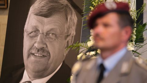 An honor guard stands at a portrait and coffin of murdered German politician Walter Lübcke at his memorial service on June 13.