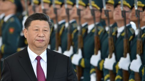 Chinese President Xi Jinping walks past honour guards during a welcoming ceremony prior to the talks with his Kyrgyz counterpart in Bishkek on June 13.