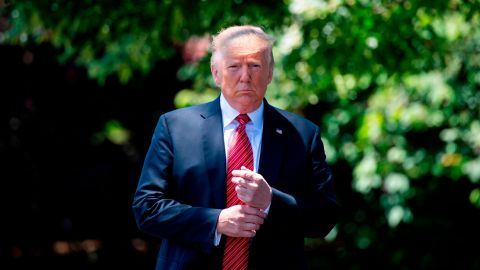 US President Donald Trump walks out of the Oval Office to speak with reporters at the White House in Washington, DC, on June 11, 2019. (JIM WATSON/AFP/Getty Images)