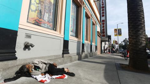 LOS ANGELES, CALIFORNIA - JUNE 06: A man sleeps on the street near Hollywood Boulevard on June 06, 2019 in Los Angeles, California. The homeless population count in Los Angeles County leapt 12 percent in the past year to almost 59,000, according to officials. A lack of affordable housing in Los Angeles is the primary factor driving the spike in homelessness, according to Los Angeles Mayor Eric Garcetti.  (Photo by Mario Tama/Getty Images)