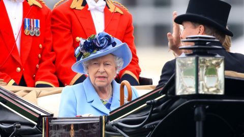 Britain's Queen Elizabeth II riding in the leading carriage during the Royal Procession to open Royal Ascot 2019.