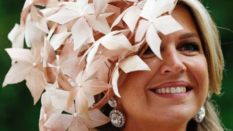 Queen Maxima is full of smiles as she waved to racegoers.