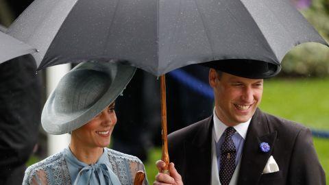 Britain's Catherine, Duchess of Cambridge and Prince William enjoy the occasion despite the rain.