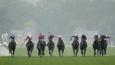 Ryan Moore rode Circus Maximus (second left, white cap) to victory in the showpiece St James's Palace Stakes ahead of the third-placed Frankie Dettori-trained favorite Too Darn Hot (in pink, center).